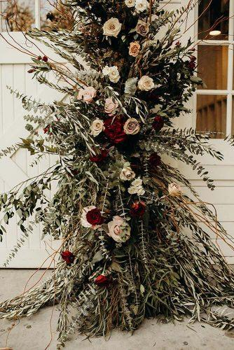 bohemian wedding decorations pale and dark red roses a lot of greenery details phil chester