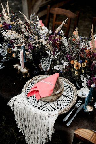 bohemian wedding decorations place setting moody table setting with bright wildflowers lilly red creative