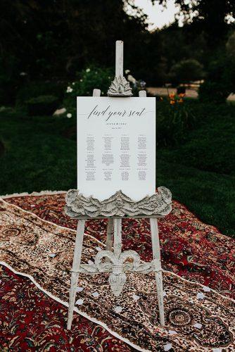 bohemian wedding decorations place setting signs on ethnic red carpet alexandria monette