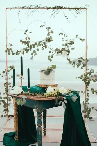bohemian wedding decorations reception dessert stand hanging hoops with greenery and white flowers latophotography