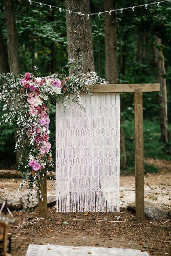 bohemian wedding decorations simple wooden arch with pink flowers and macrame greenery we laugh we love