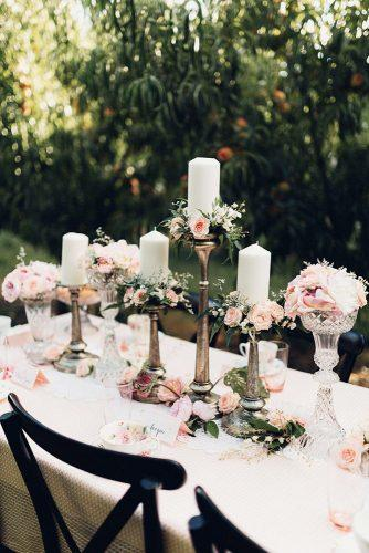 bohemian wedding decorations tall candles with flowers small roses miss gen