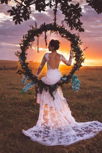 bohemian wedding hoop shaped swing with greenery and blue orchids najudecastro