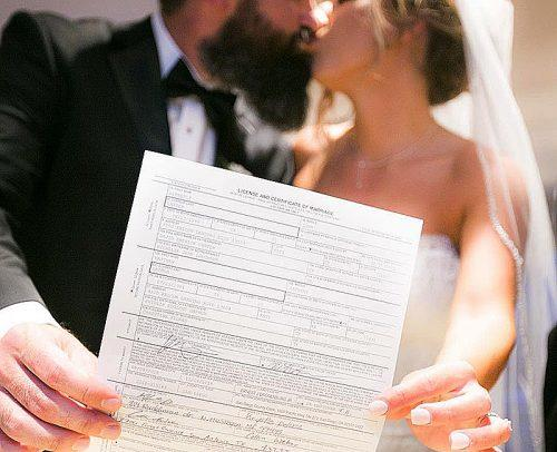 how to change your name newlyweds kissing holding marriage license