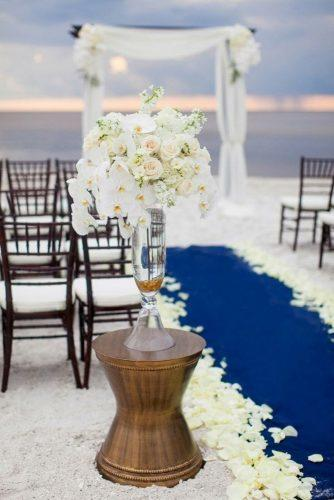 nautical wedding blue aisle with white orchids flowers in tall glass vase jamie lee photography