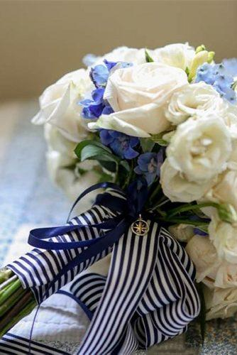 nautical wedding bouquet with white and blue flowers with stripes ribbons and suspension compass rodeoandco
