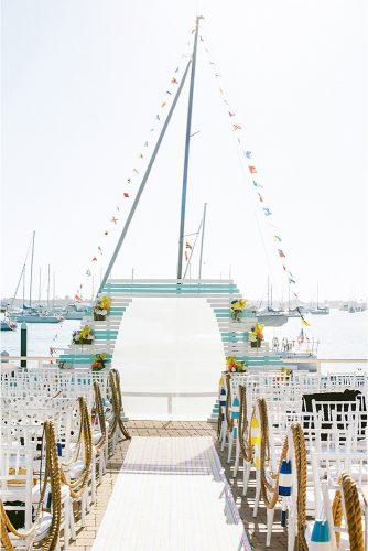 nautical wedding bright yellow blue wooden arch ropes in the aisle sargeant creative