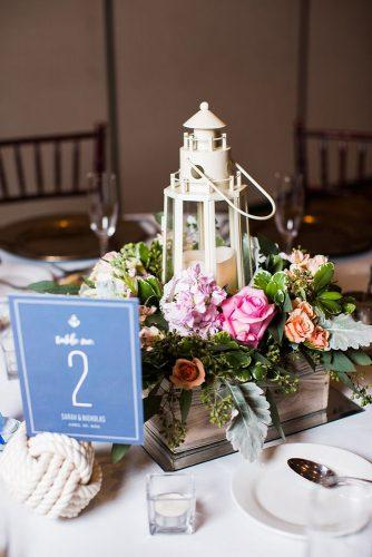 nautical wedding centerpiece in wooden crate lighthouse with bright flowers leigh skaggs photography
