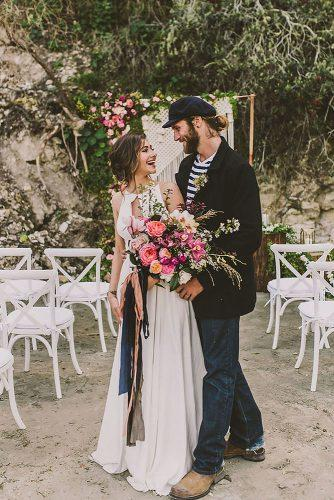 nautical wedding ceremony elegant bride with bright bouquet and groom in a marine suit michelle roller
