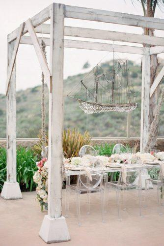 nautical wedding outdoor reception with hanging vintage ship above the minimalist table jose villa photography