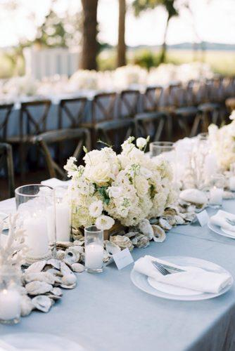 nautical wedding with white flowers and seashells tablerunner landon jacob photography