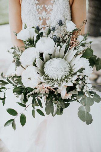 sage green wedding bouquet with protea greenery and white flowers alex lasota photography