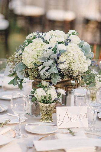 sage green wedding centerpiece elegant with white flowers in vintage gold vase we heart photography