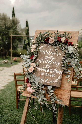 sage green wedding ceremony woodland sign with greenery and roses federica_cavicchi