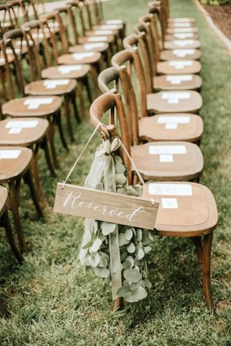 sage green wedding outdoor aisle with greenery and wooden signs t&k photography