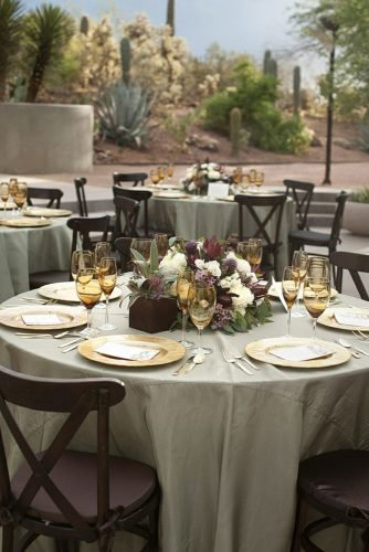 sage green wedding outdoor desert reception with flowers on tables laura segall photography