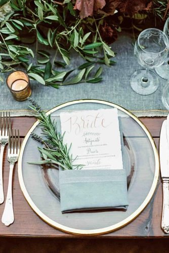 sage green wedding place setting with greenery and menu décor laurenfairphotography