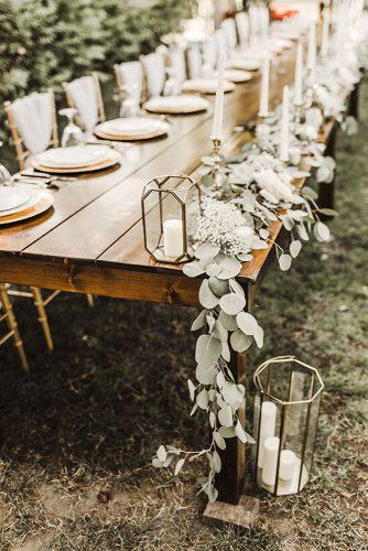 sage green wedding tablerunner greenery on wooden table with geometry terrarium with candles julie bulanov photography