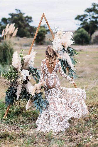 sage green wedding triangle wooden arch bohemian with pampas grass and boho bride peggysaas