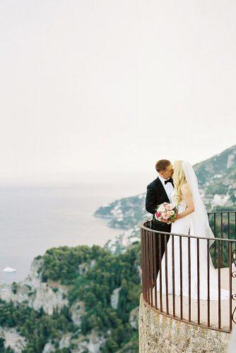 wedding photographers amazing view newlyweds kissing imryanray