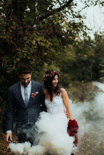 wedding photographers couple in smoke forgedinthenorth