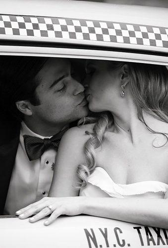 wedding photographers kiss in taxi emiliajane