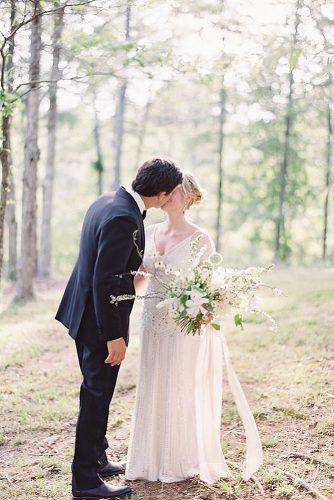 wedding photographers outdoor wedding romantic kiss ryleehitchner