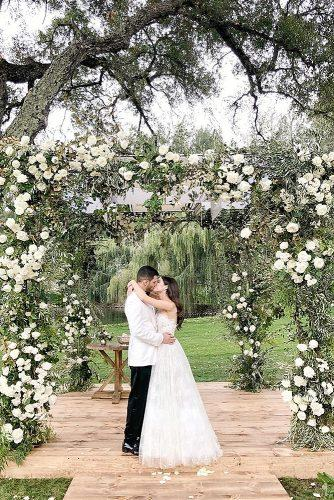 wedding photographers outdoor wedding with decor flowers newlyweds ktmerry