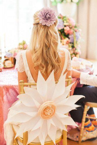 whimsical wedding decor ideas big flower on chair Roberta Facchini