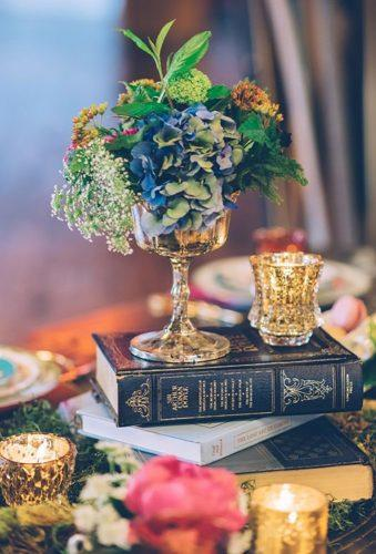 whimsical wedding decor ideas centerpiece with book Ed Aileen Photography