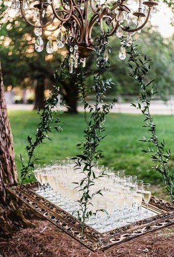 whimsical wedding decor ideas champange on the frame amiliaphotography
