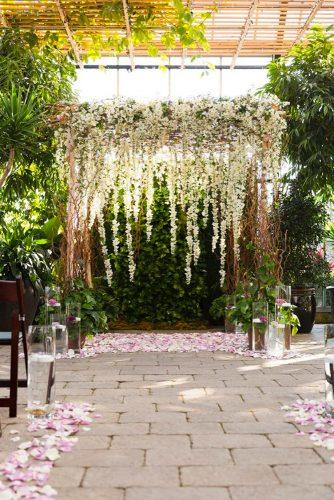 whimsical wedding decor ideas floral arch M J Photography