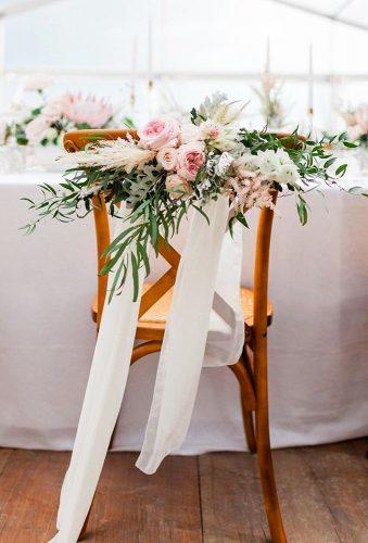 whimsical wedding decor ideas flower chair decor rorywylieweddings