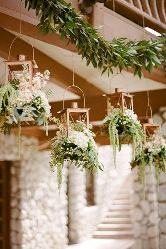 whimsical wedding flowers in lanterns Rebecca Yale Photography