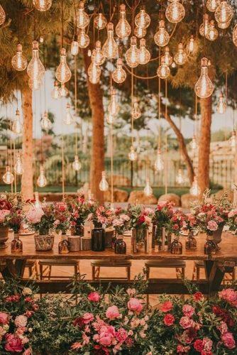 whimsical wedding reception decor with lamp palomacruzeventos