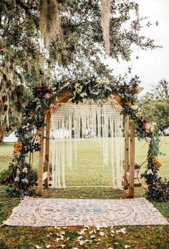 boho wedding trends arch near tree Shannon Lee Miller