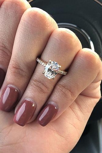 engagement ring inspiration pave band diamond classic oval cut