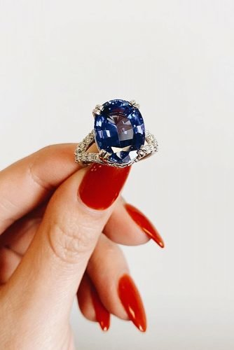 engagement ring inspiration pave band tanzanite oval cut