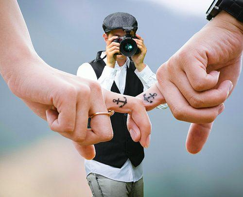 how much does a wedding photographer cost photography couple hands with tattoos