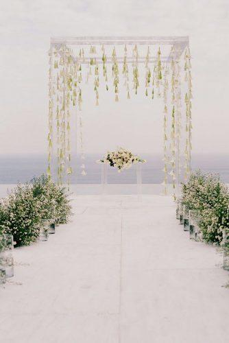 modern wedding decor ideas acrylic arch with hanging flowers and greenery aisle anggapermanaphoto