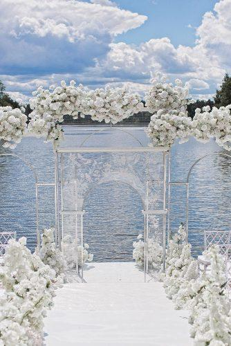 modern wedding decor ideas airy white ceremony with transparent arch akuznetshova
