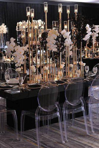 modern wedding decor ideas black and gold reception with tall candlesticks and cascading orchids signatureexposure
