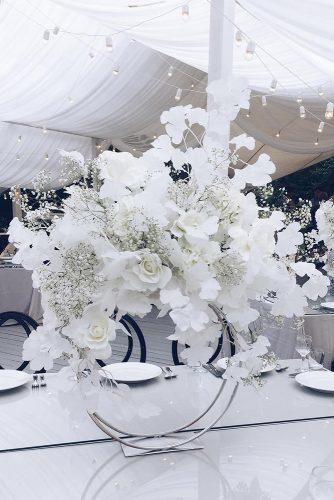 modern wedding decor ideas centerpiece white flowers on round stand nikolaizlobin