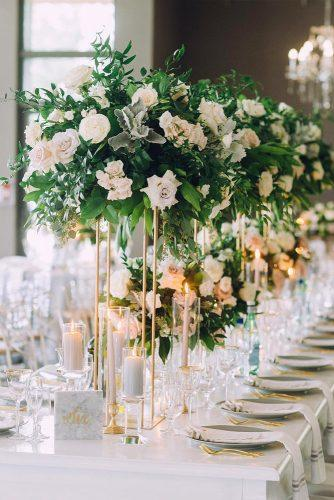 modern wedding decor ideas elegant tall centerpieces with greenery and roses on gold minimalistic stand lifeimages