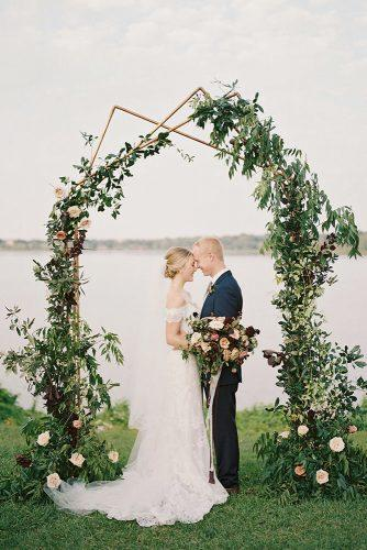 modern wedding decor ideas geometry arch with greenry and flowers charla storey photography