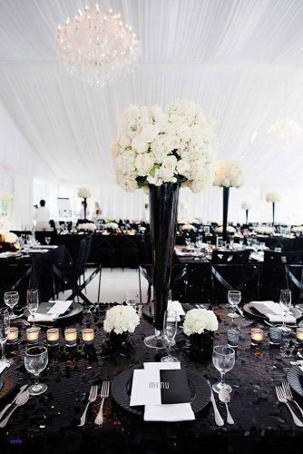 modern wedding decor ideas reception white tent and flowers in tall vase black table and chairs kortnee kate photography
