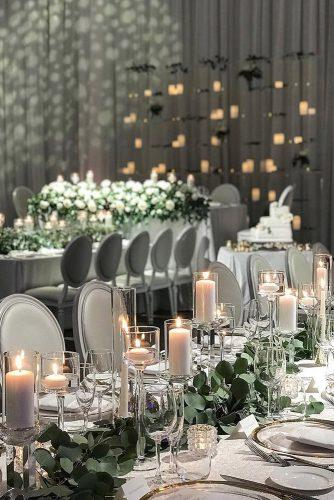 modern wedding decor ideas reception with candles and greenery in grey tones chateau.le.parc