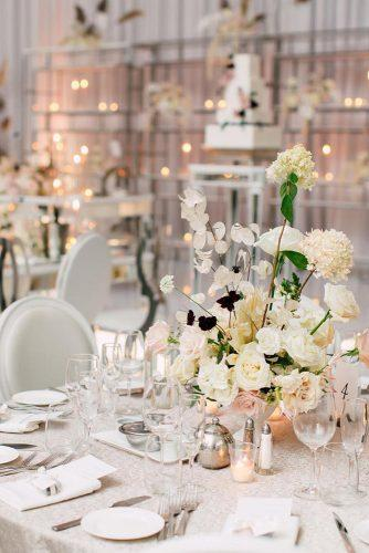 modern wedding decor ideas reception with round tables and flower centerpieces purpletreephotography