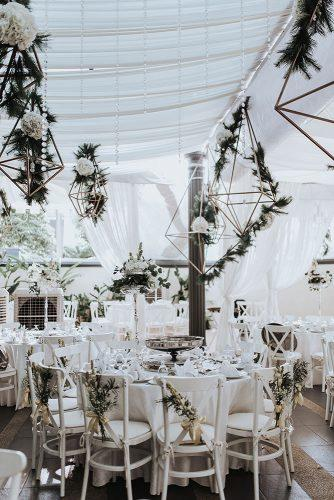modern wedding decor ideas stylish reception under white tent with greenery and hanging geometry jasmine abdullah