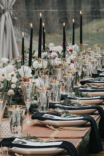 modern wedding decor ideas table with black candles and napkins greenery and white flowers we_the_wild